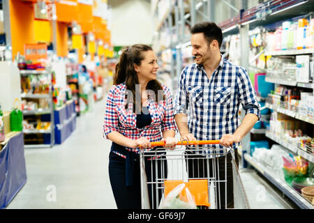 Couple shopping together  in supermarket - Stock Photo