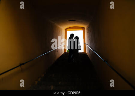 Silhouette of a couple in love hugging - Stock Photo