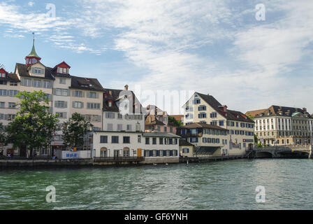 Zurich, Switzerland- august 22, 2010: Traditional houses on embankment Limmat river in historic Zurich city center - Stock Photo