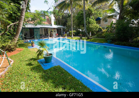KEY WEST, FLORIDA, USA - MAY 03, 2016: Swimming pool in the garden of the Hemingway House in Key West in Florida. - Stock Photo