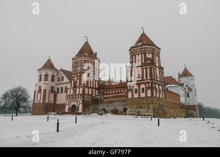 Mir medieval castle complex in winter with snow. Belarus (UNESCO world heritage site) - Stock Photo