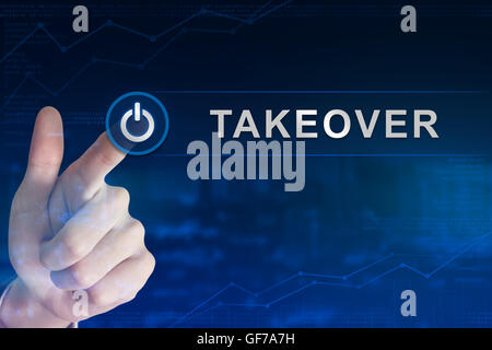 double exposure business hand clicking takeover button with blurred background - Stock Photo