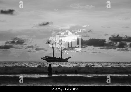 Dramatic sea and transport boat with sunset in over light the sun black and white tone - Stock Photo