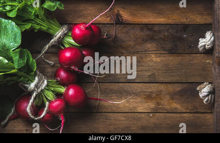 Fresh radish banches on wooden tray background, copy space - Stock Photo
