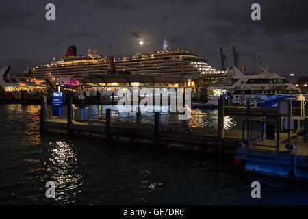 Nighttime view of Cunard cruise liner Queen Victoria berthed in Auckland, New Zealand. - Stock Photo