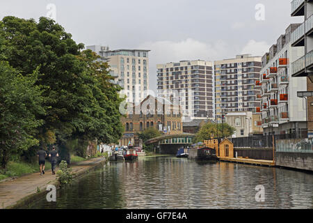 The Regents Canal in Hoxton, north London. Looking East towards Southgate Road bridge. Shows housboats, warehouses - Stock Photo