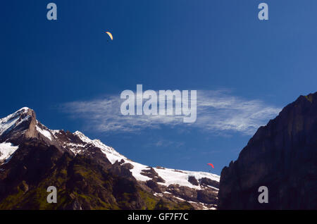 Paragliding above Alps (Switzerland) in Jungfrau Region - Stock Photo
