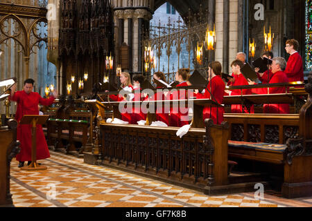Choirmaster conductor of choir from USA singing / choristers sing / chorister sings / choirs pracising at Worcester - Stock Photo