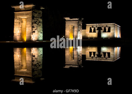 Temple Of Debod Reflecting In Water At Night - Stock Photo
