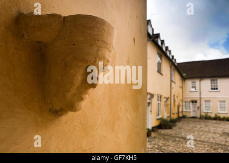UK, England, Norfolk, King's Lynn, Nelson's Lane, Hampton Court, medieval head in entrance to C14th jettied building - Stock Photo