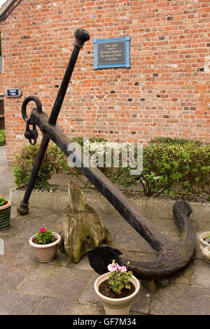 UK, England, Norfolk, King's Lynn, Trues Yard Fisherfolk Museum, old iron ship's anchor and 1993 opening plaque - Stock Photo