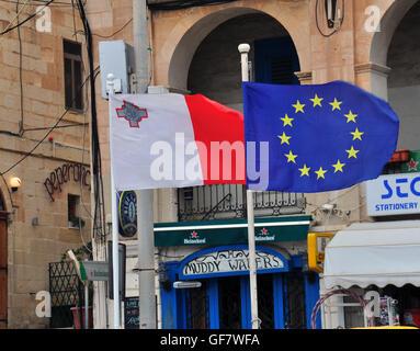 VALLETTA, MALTA - FEBRUARY 20: Flags of Lamta and European Union on the street of Valletta on February 20, 2014. - Stock Photo