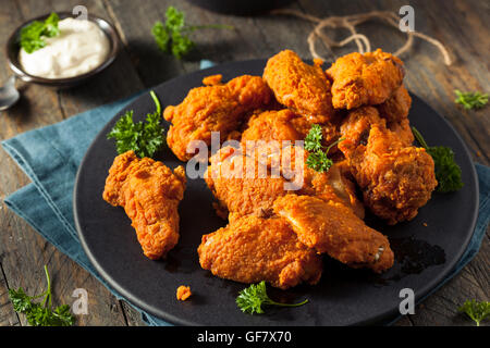 Spicy Deep Fried Breaded Chicken Wings with Ranch - Stock Photo