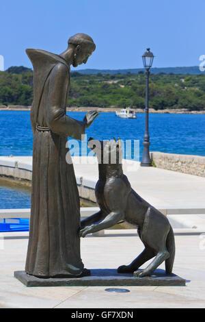 Statue of Saint Francis (1181/1182 - 3 October 1226), founder of the Franciscan Order on Kosljun Island, Croatia - Stock Photo