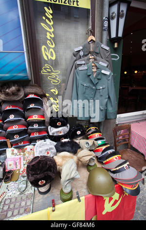 Sale stand of Soviet and DDR military stuff near Checkpoint Charlie in Berlin Germany. - Stock Photo