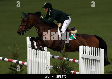 Ireland's Billy Twomey riding Diaghilev jumps in the Furusiyya FEI Nations Cup during day four of the Longines Royal - Stock Photo