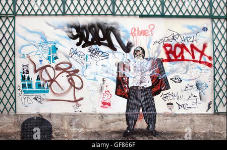 Graffiti art on a wall in Paris France - Stock Photo