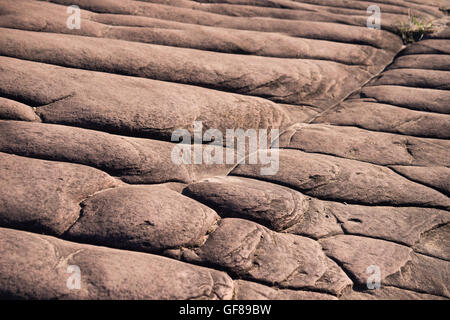 Layers of sedimentary sandstone rock. - Stock Photo