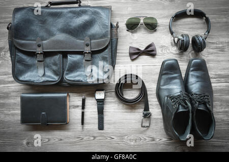 Men's casual outfits with accessories on on wood background with vitage color still life - Stock Photo