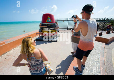 KEY WEST, FLORIDA, USA - MAY 02, 2016: Tourists are making pictures at the southernmost point of the USA in Key - Stock Photo