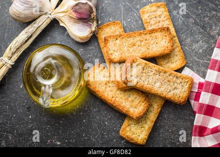 Crispy Italian antipasto bruschetta on kitchen table. - Stock Photo