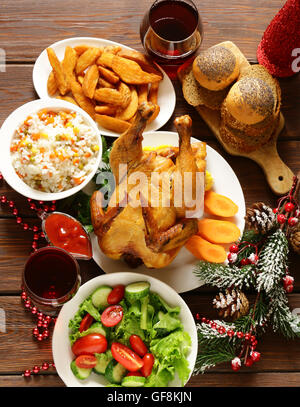 traditional food for Christmas dinner, festive table setting and decorations - Stock Photo