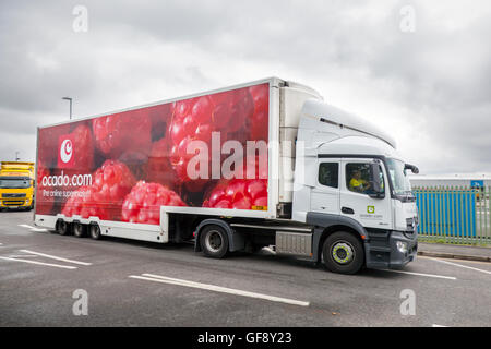 Ocado raspberry van livery & Morrisons supermarket grocery delivery service food store vehicles; online delivery - Stock Photo