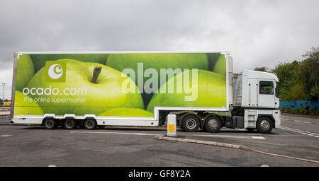 Ocado Apple Van livery & Morrisons supermarket grocery delivery service food store vehicles; online delivery fleet - Stock Photo