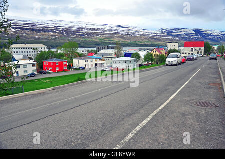AKUREYRI, ICELAND - JUNE 4: Cars on the typical street of Akureyri downtown on June 4, 2013. - Stock Photo