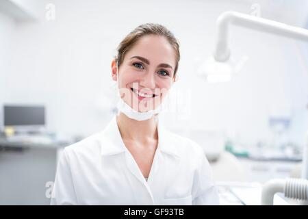 MODEL RELEASED. Close-up of young woman dentist, portrait. - Stock Photo