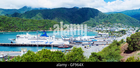The ferry terminal and town of Picton in New Zealand with the now retired DEV Arahura ferry in port. - Stock Photo