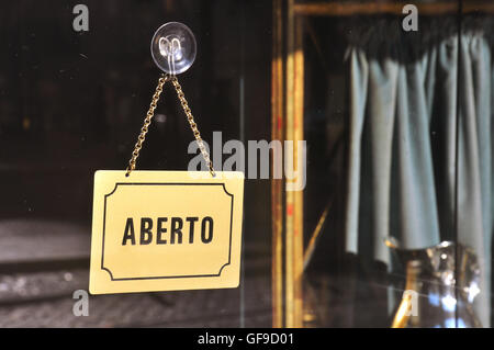 Sign 'Open' in old cafe in Lisbon, Portugal - Stock Photo