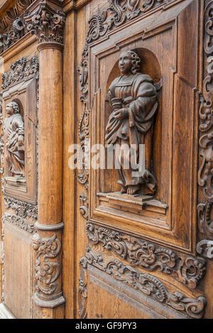 Ancient wooden door in stone building in Tallinn - Stock Photo