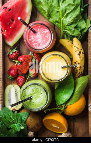 Freshly blended fruit smoothies of various colors and tastes - Stock Photo
