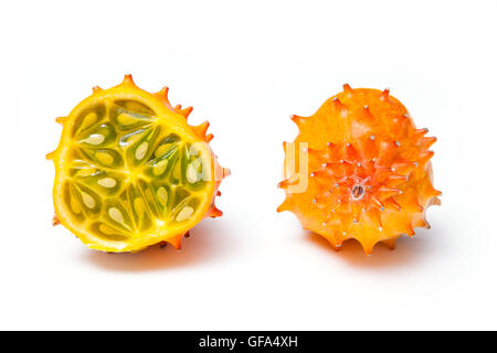 Cucumis metuliferus, horned melon or kiwano isolated on a white studio background. - Stock Photo