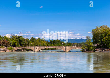 View of Bridge across Rhine River in Rheinfelden on the border between Germany and Switzerland, on a sunny summer - Stock Photo
