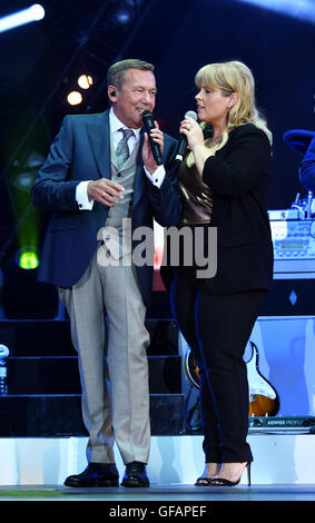 Dresden, Germany. 28th July, 2016. Singers Roland Kaiser and Maite Kelly stand on stage during the film evening - Stock Photo