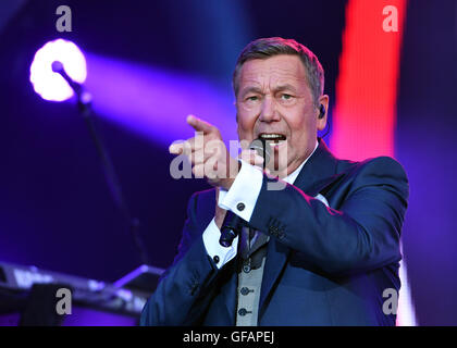 Dresden, Germany. 28th July, 2016. Singer Roland Kaiser stands on stage during the film evening at his open-air - Stock Photo