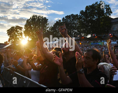 Dresden, Germany. 28th July, 2016. Fans of singer Roland Kaiser cheer during the film evening at the open-air concert - Stock Photo