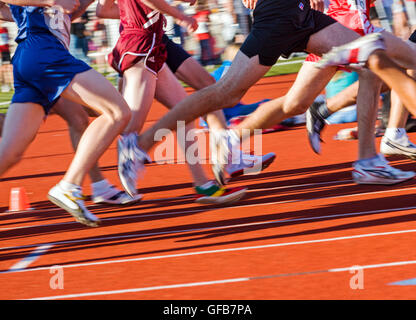 Motion blur of legs of high school students competing at the Henderson Invitational Track & Field Meet - Stock Photo