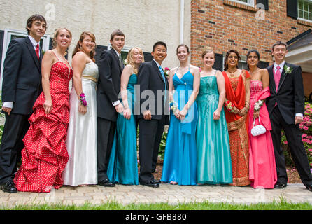 Teenagers in dresses, suits, & tuxedos ready for senior high school ...