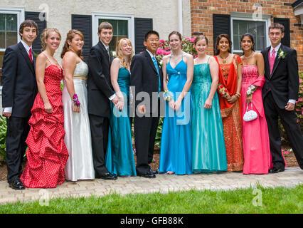 Teenage girls posing in prom dresses, Englefield Green, Surrey Stock ...