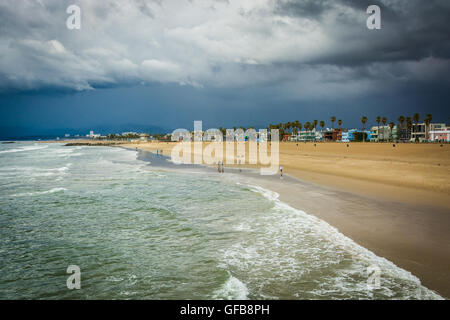 View of dark storm clouds over the beach in Venice Beach, Los Angeles, California. - Stock Photo