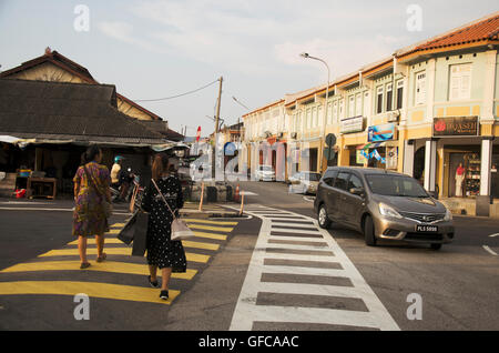 Traffic road and traveler thai people walking cross over road at crosswalk on street at George Town and street art - Stock Photo