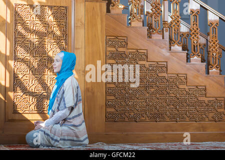 Beautiful teen high school girl wearing colorful muslim clothing - Stock Photo
