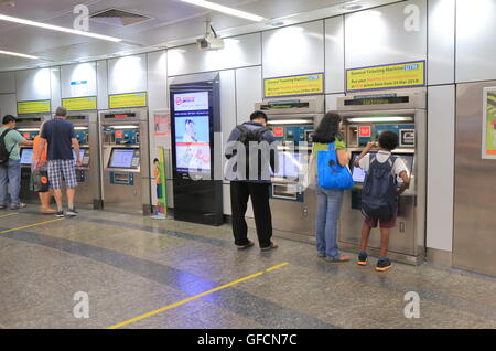 Ppeople buy tickets at Orchard MRT station in Singapore. Stock Photo