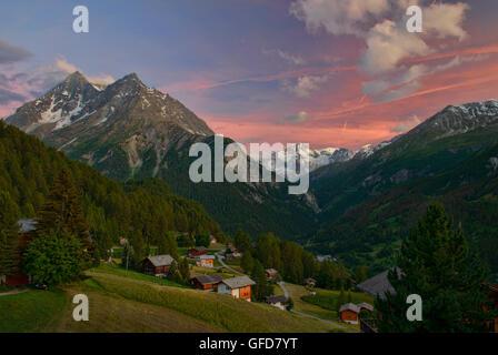 Beautiful alpine  sunset views of Pigne d'Arolla from the hamlet of La Sage, Val d'Hérens, Switzerland - Stock Photo