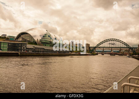 A view of the Quayside at Gateshead and Newcastle featuring the Sage and Tyne bridges - Stock Photo