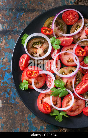 Tomatoes and onion salad - Stock Photo