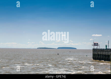 The islands of Steep Holm and Flat Holm in the Bristol Channel viewed from the Cardiff Bay barrage , South Glamorgan, - Stock Photo
